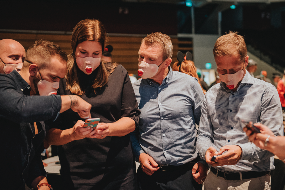 People wearing funny masks looking at the Cultr app